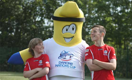 Danone Nations Cup mascot with children